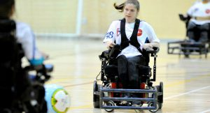 A person plays powerchair soccer