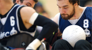People playing wheelchair rugby